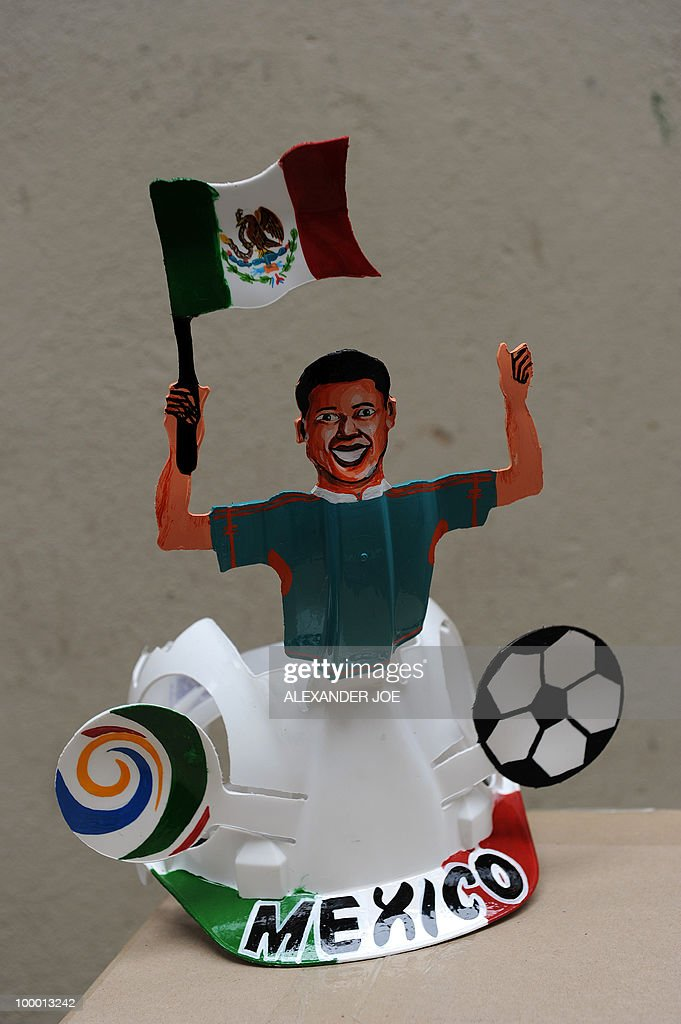 A South African hard hat known as 'Makarapas' made for the Mexican football team and its supporters is pictured in Johannesburg on March 24, 2010. The 'Makarapas', a decorated plastic hard hat, are created by carving shapes into construction hats and painting them in team colours, a process that can take four days to complete. As the world prepares for Africa's first World Cup, interest in the hats is growing in the continent. South African architect Paul Wygers, who designed the machine to create the cut outs in the hard hats, has received an order from football governing body FIFA for 2,000 Makarapas for the twelve of the top teams.
