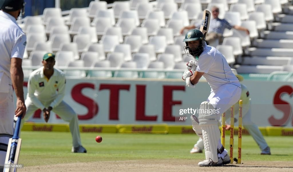 South African Hashim Amla plays a shot from unseen Pakistan cricketer Muhammad Irfan during the 2nd Test between South Africa and Pakistan , in Cape Town at Newlands on February 15, 2013.