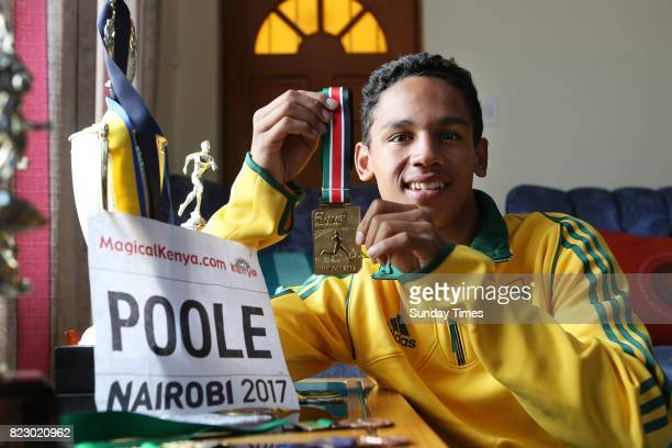 South African high jumper Breyton Poole 17 poses with his gold medal during an interview at his home on July 20 2017 in Cape Town South Africa The...