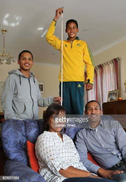South African high jumper Breyton Poole is seen with his brother Hagan his parents Charmaine and Herman Poole during an interview at his home on July...
