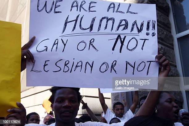 South African human rights activists protest protest against homosexuals imprisoned in Malawi outside the Home Affairs' Offices May 20 2010 in Cape...