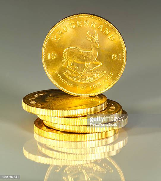 South African Krugerrand 1oz Gold Coins stacked with reflection