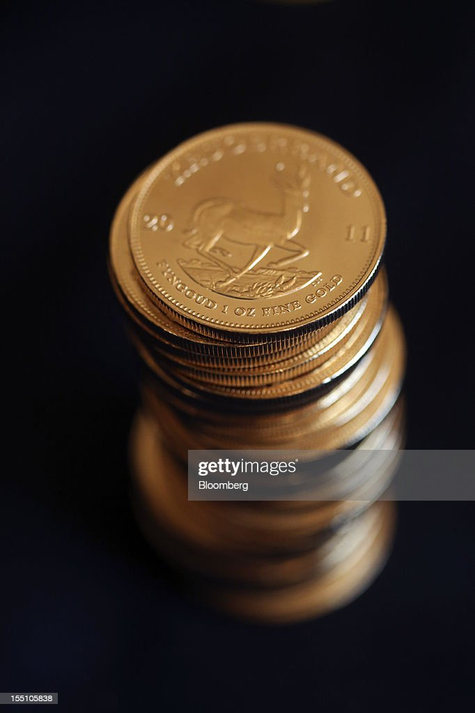 South African krugerrand gold coins are seen in this arranged photograph at Gold Investments Ltd. bullion dealers in London, U.K., on Thursday, Nov. 1, 2012. Gold may rise for a third straight day, as China's manufacturing expanded for the first time in three months, increasing demand prospects for commodities. Photographer: Chris Ratcliffe/Bloomberg via Getty Images