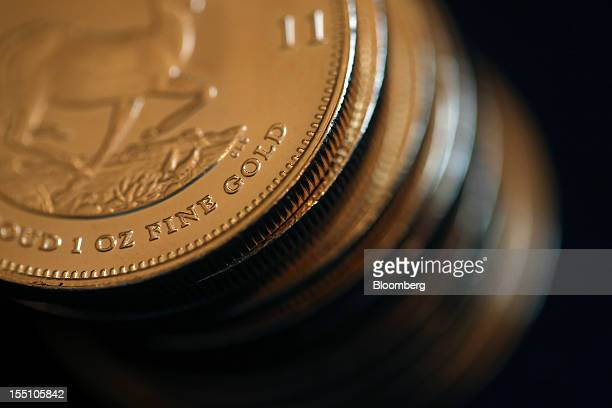 South African krugerrand gold coins are seen in this arranged photograph at Gold Investments Ltd bullion dealers in London UK on Thursday Nov 1 2012...