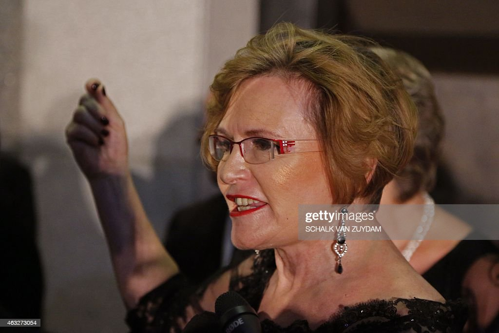 South African leader of the Democratic Alliance (DA) <a gi-track='captionPersonalityLinkClicked' href=/galleries/search?phrase=Helen+Zille&family=editorial&specificpeople=869313 ng-click='$event.stopPropagation()'>Helen Zille</a> leaves the parliament after security forces evicted a group of radical lawmakers during the President's State of the Nation address in Cape Town on February 12, 2015. Security forces were called to eject radical lawmakers who interrupted South African President Jacob Zuma's annual state of the nation address to parliament. The members of the Economic Freedom fighters led by populist firebrand Julius Malema had caused uproar as they demanded that Zuma repay millions of taxpayers money spent on his private residence.