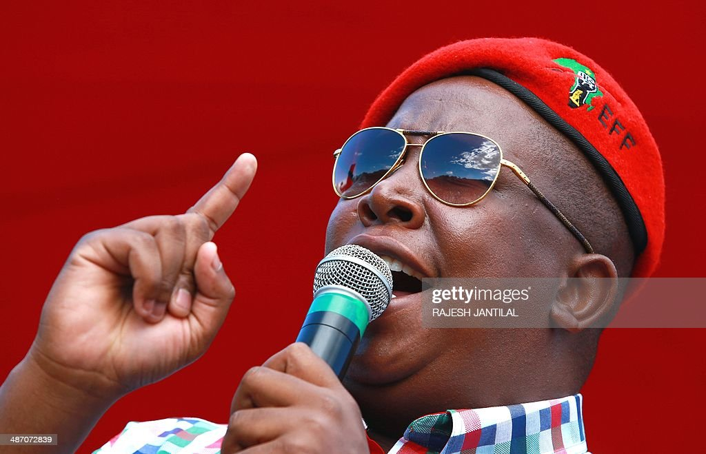 South African leader of the Economic Freedom Fighters (EFF) party and former African National Congress (ANC) Youth League leader Julius Malema addresses supporters during an election campaign rally in Umlazi, south of Durban, South Africa, on April 27, 2014. South Africans are going to the polls for a general election on May 7, 2014. AFP PHOTO / RAJESH JANTILAL