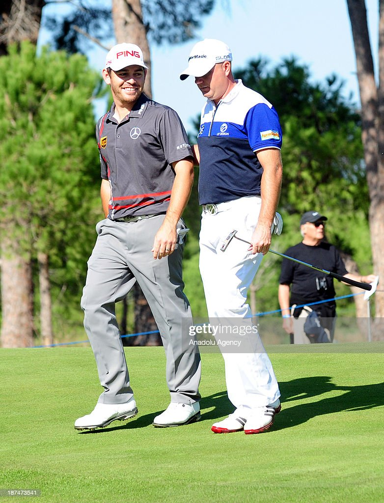 South African Louis Oosthuizen (L) and English Graeme Storm are seeing during the 3rd day of the 'Turkish Airlines Open Golf Tournament' of PGA European Tour Final Series on November 9, 2013 in Antalya, Turkey. Turkish Airlines Open 2013 Golf Tournament held in Belek town of southern Antalya province between November 7 and 10, 2013.