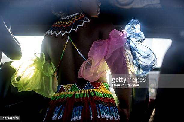 South African maidens bare breasted as the tradition requires prepare themselves for the Reed Dance ceremony on September 5 2014 at the eNyokeni...