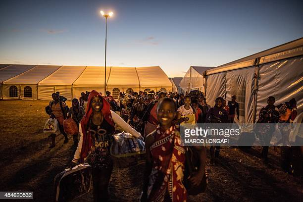 South African maidens carrying their belongings arrive on September 4 2014 at the eNyokeni Royal Palace in Nongoma in the KwaZuluNatal region for the...