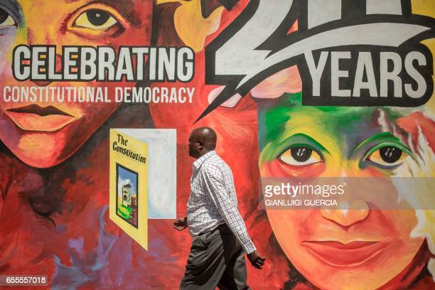 A South African man walks by a commemorative graffiti wall in the Sharpeville Heritage Memorial compound on the eve of the 57th anniversary of the...
