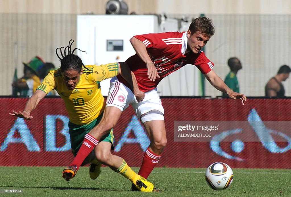 South African midfielder Steven Pienaar (L) is tackled by Denmark's Jakob Poulsen during a friendly football match at the Super Stadium, Atteridgeville in Pretoria on June 5, 2010 ahead of the FIFA 2010 World Cup in South Africa.