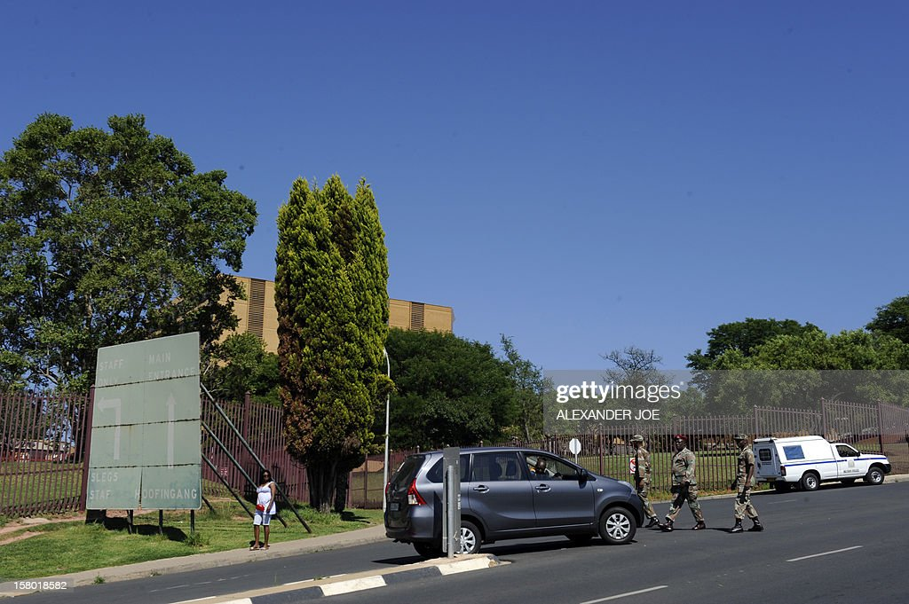 South African military police check cars on December 9, 2012 going into the 1 Military Hospital in Pretoria, where South Africa's former president Nelson Mandela is said to be hospitalised. Mandela was admitted to a hospital for tests consistent with old age and is doing well, the office of South Africa's president, Jacob Zuma, announced. AFP PHOTO / ALEXANDER JOE