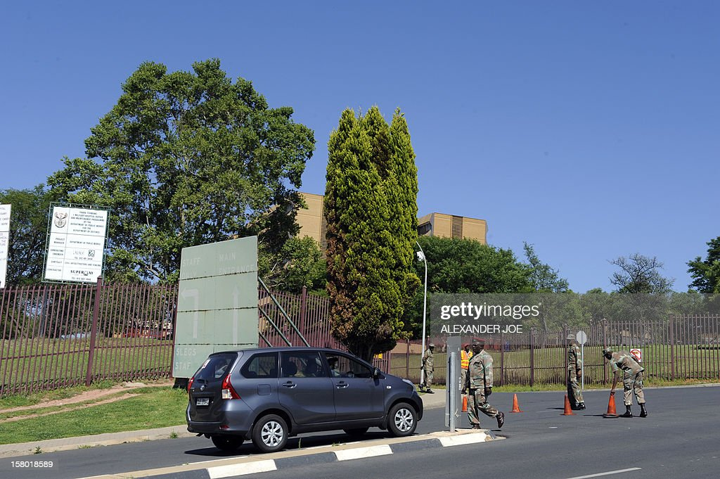 South African military police check cars on December 9, 2012 going into the 1 Military Hospital in Pretoria, where South Africa's former president Nelson Mandela is said to be hospitalised. Mandela was admitted to a hospital for tests consistent with old age and is doing well, the office of South Africa's president, Jacob Zuma, announced.