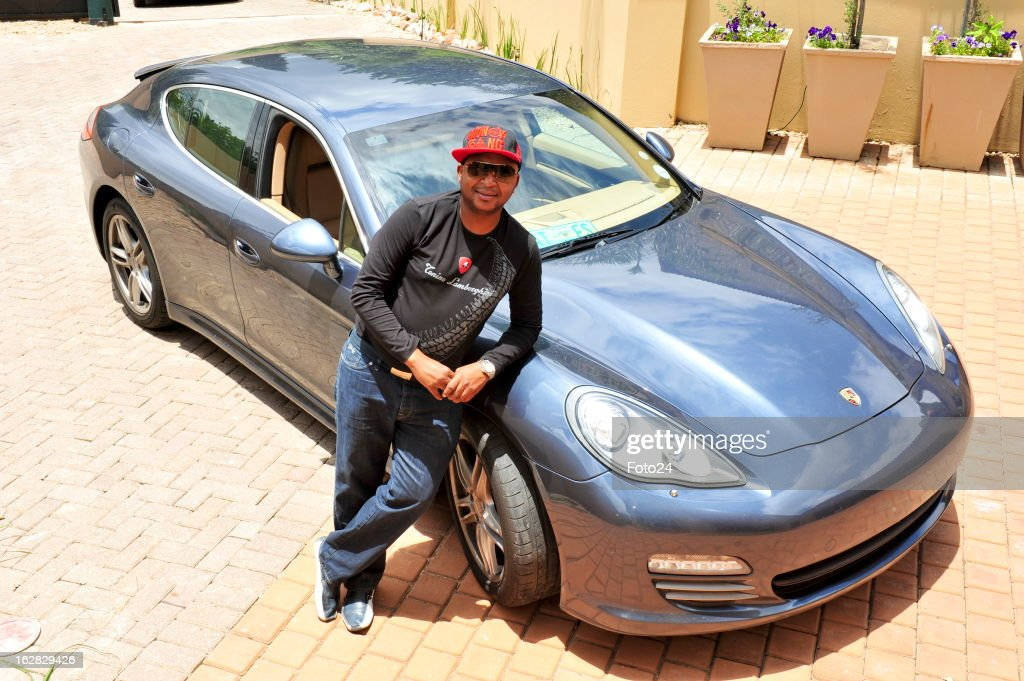 South African millionaire Kenny Kunene shows off his Porsche Panamera on January 18 in Johannesburg, South Africa. Sports car owners have made an outcry about being targeted by the police for bribes, and claim that they are frequently pulled over when they drive their expensive cars. Some owners though, like Kenny Kunene, say that the police are only doing their job.