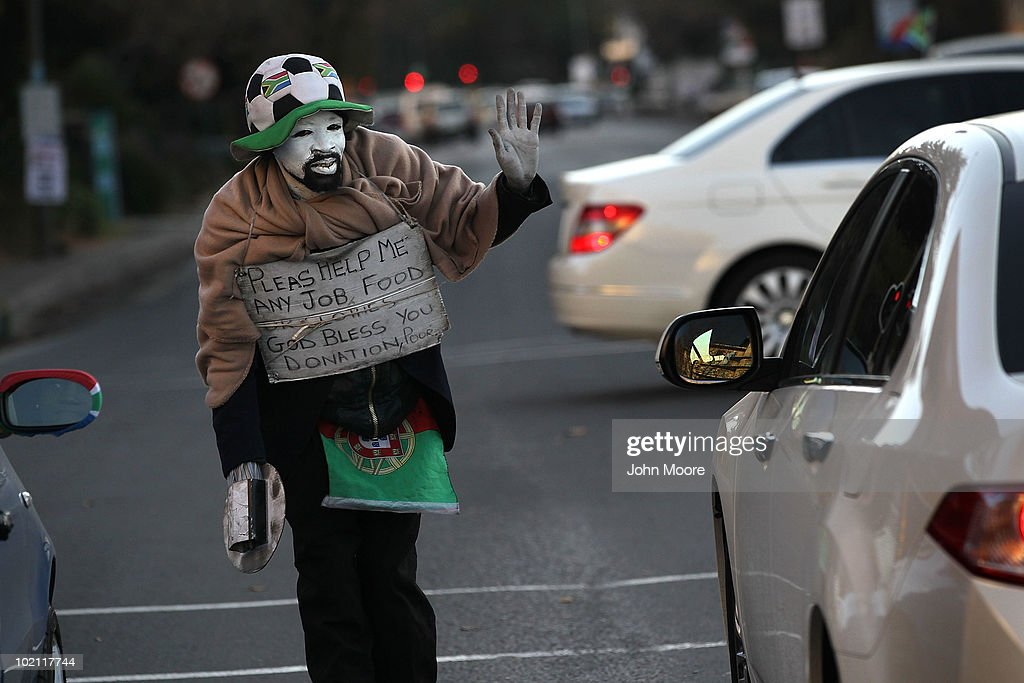 South African mime Leonard Madlala, 34, uses a soccer World Cup theme while working an intersection for spare change on June 15, 2010 in Johannesburg, South Africa. A former security guard, Madlala said he has been out of work for a year after he was shot during a burglary while guarding a Johannesburg shopping center.
