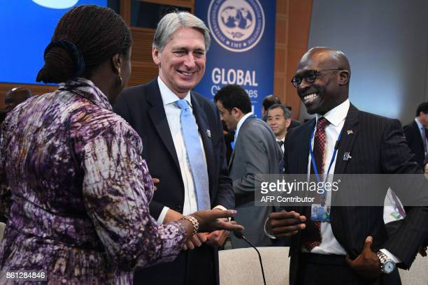 South African Minister of Finance Malusi Gigaba speaks with British Chancellor of the Exchequer Philip Hammond and Nigerian Minister of Finance Kemi...