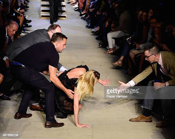 South African model Candice Swanepoel stumbles and falls on runway during the Givenchy Spring 2016 fashion show during New York Fashion Week at Pier...