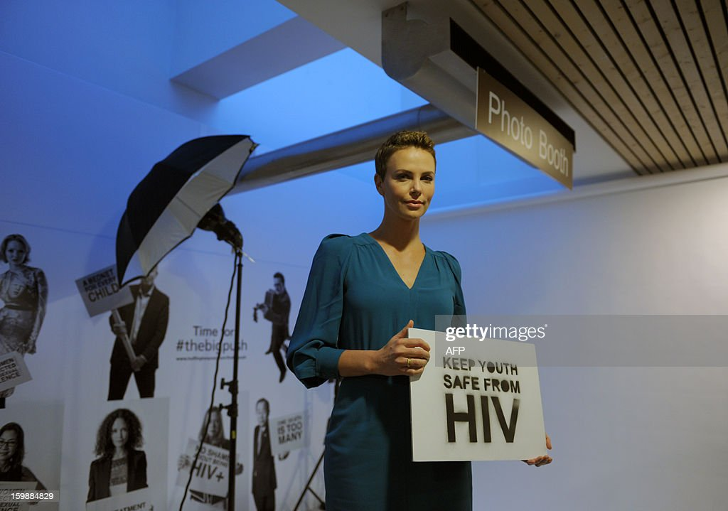 South African Movie star and HIV/AIDS campaigner Charlize Theron poses after having her portrait taken for the Global Fund's Big Push campaign at the congress centre in Davos on January 22, 2013 prior to the opening of the World Economic Forum . The meeting gathers some of the world's leading politicians and economists and is viewed as a global think tank forum.
