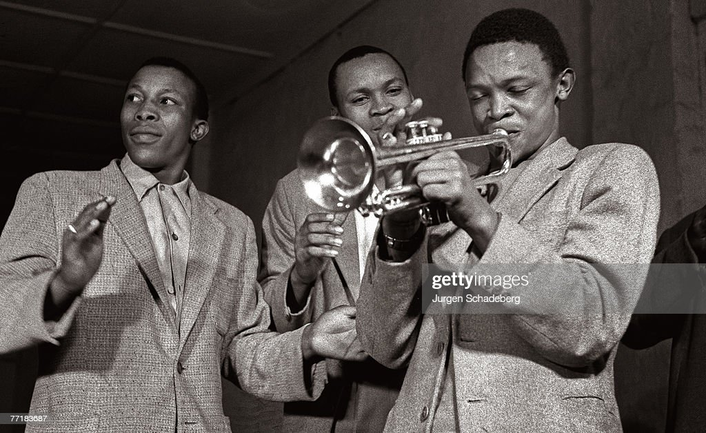 South African musician Hugh Masekela plays the trumpet he has just received as a gift from Louis Armstrong, via local chaplain Father Trevor Huddleston, 1954.
