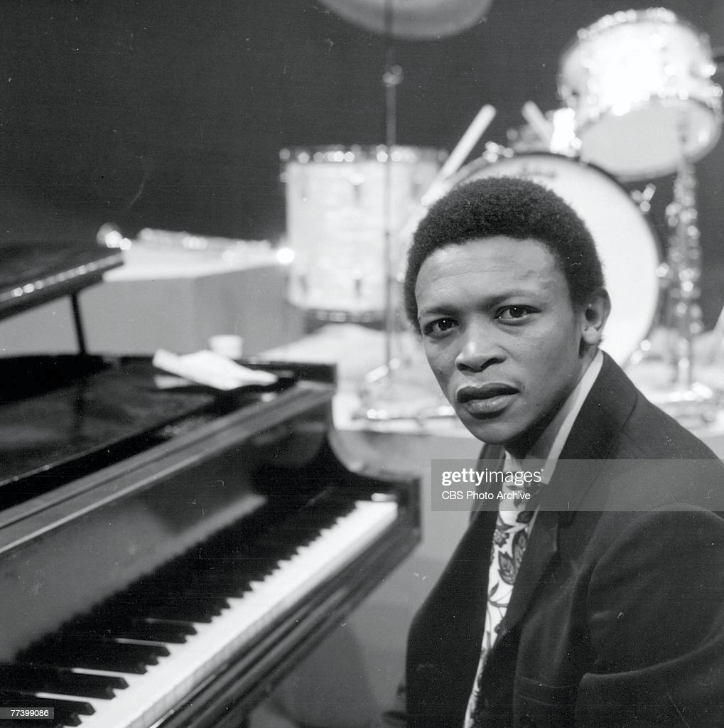 South African musician Hugh Masekela sits at a piano on an episode of the television program 'Dial M for Music,' May 25, 1968.