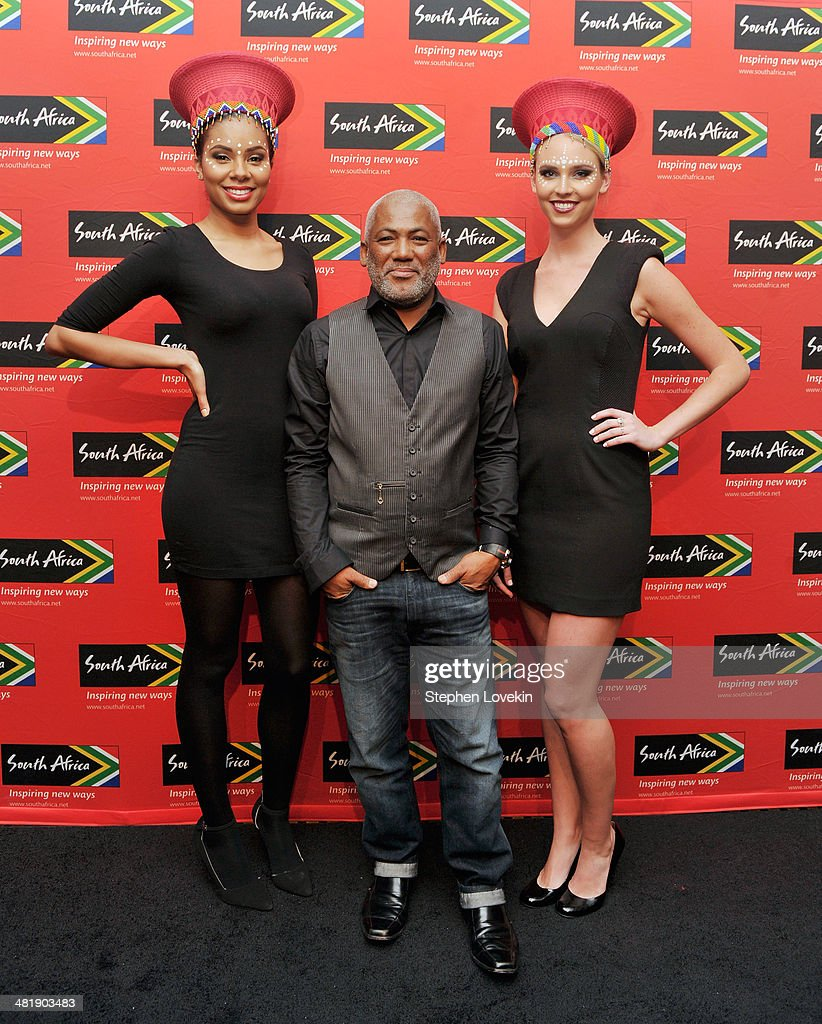 South African musician Jonathan Butler(center) poses with models representing the South African Tourism Bureau at the 2014 Ubuntu Awards at Gotham Hall on April 1, 2014 in New York City.
