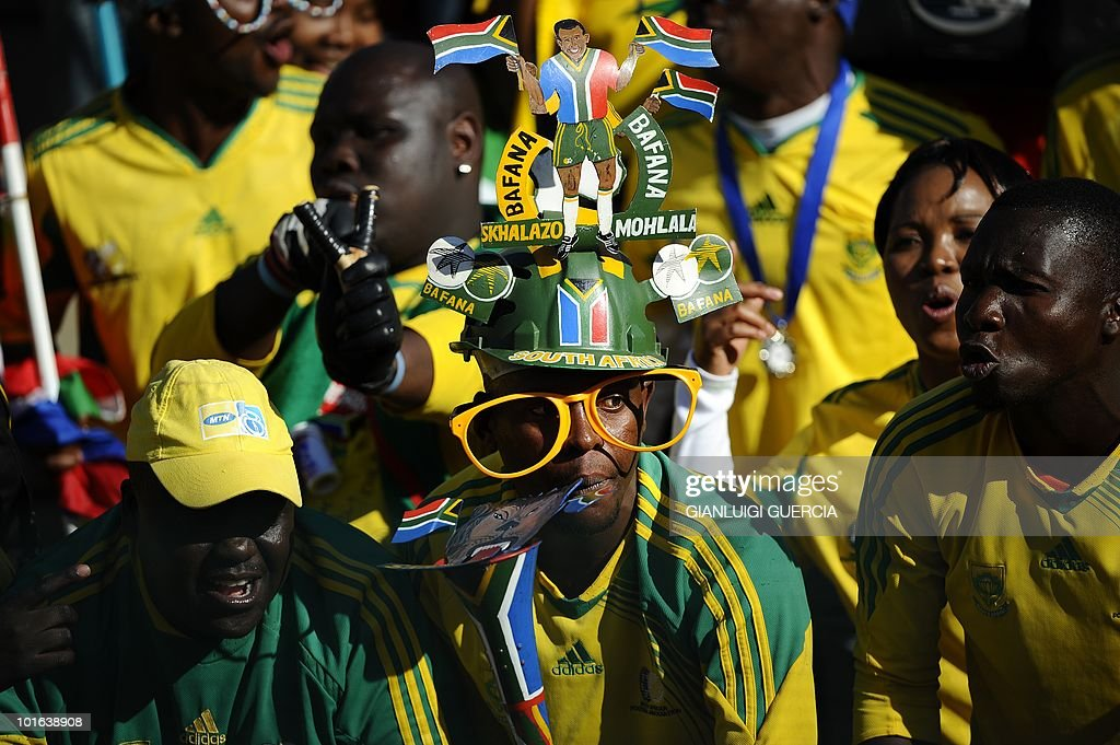 South African national foootball team supporters cheer on June 5, 2010 during a friendly match between South Africa and Denmark at Superstadium in Pretoria ahead of the 2010 FIFA World Cup in South Africa.