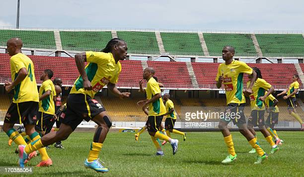 South African national football team players take part in a training session on June 12 2013 at the Amadou Ahidjo stadium in Yaounde befor their 2014...