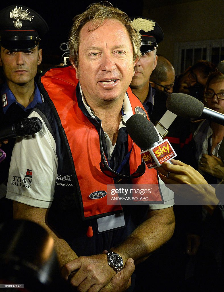 South African Nick Sloan, senior salvage master for Titan-Micoperi, answers questions from journalists at the end of rotation of the wreck of Italy's Costa Concordia cruise ship, after it emerged from water on September 17, 2013 near the harbour of Giglio Porto. Salvage operators in Italy lifted the Costa Concordia cruise ship upright from its watery grave off the island of Giglio on September 17 in the biggest ever project of its kind. AFP PHOTO / ANDREAS SOLARO