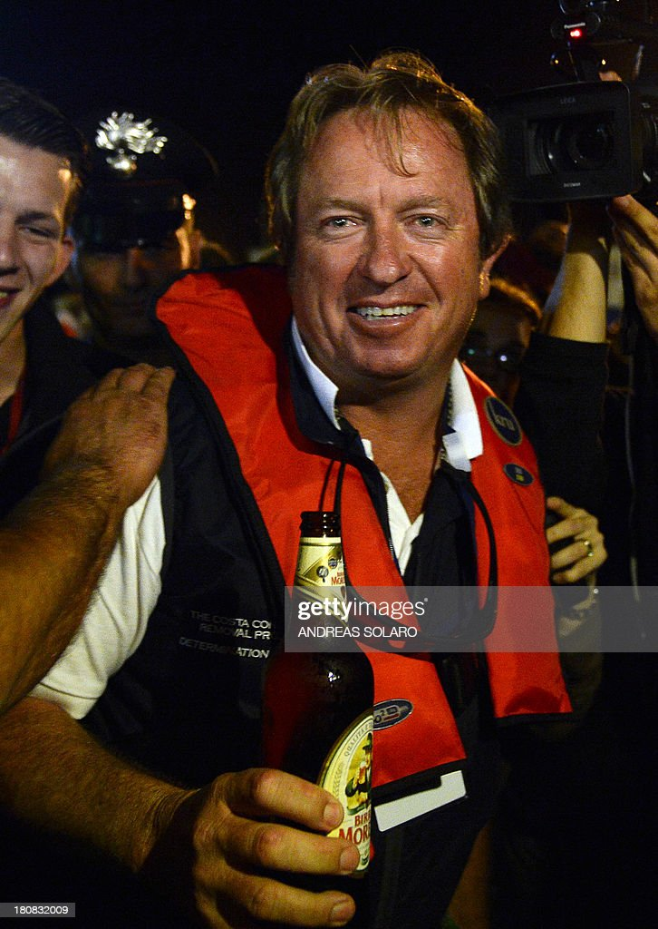 South African Nick Sloan, senior salvage master of Titan-Micoperi, smiles at the end of rotation of the wreck of Italy's Costa Concordia cruise ship on September 17, 2013 near the harbour of Giglio Porto. Salvage operators in Italy lifted the Costa Concordia cruise ship upright from its watery grave off the island of Giglio in the biggest ever project of its kind. The ship's horn sounded for the first time since the January 13, 2012 tragedy, its sound mixing with applause and cheers in the port in a dramatic climax to the massive salvage operation. Local residents and survivors spoke of an eerie feeling as the ship rose, saying the sight reminded them of the tragedy that claimed 32 lives.