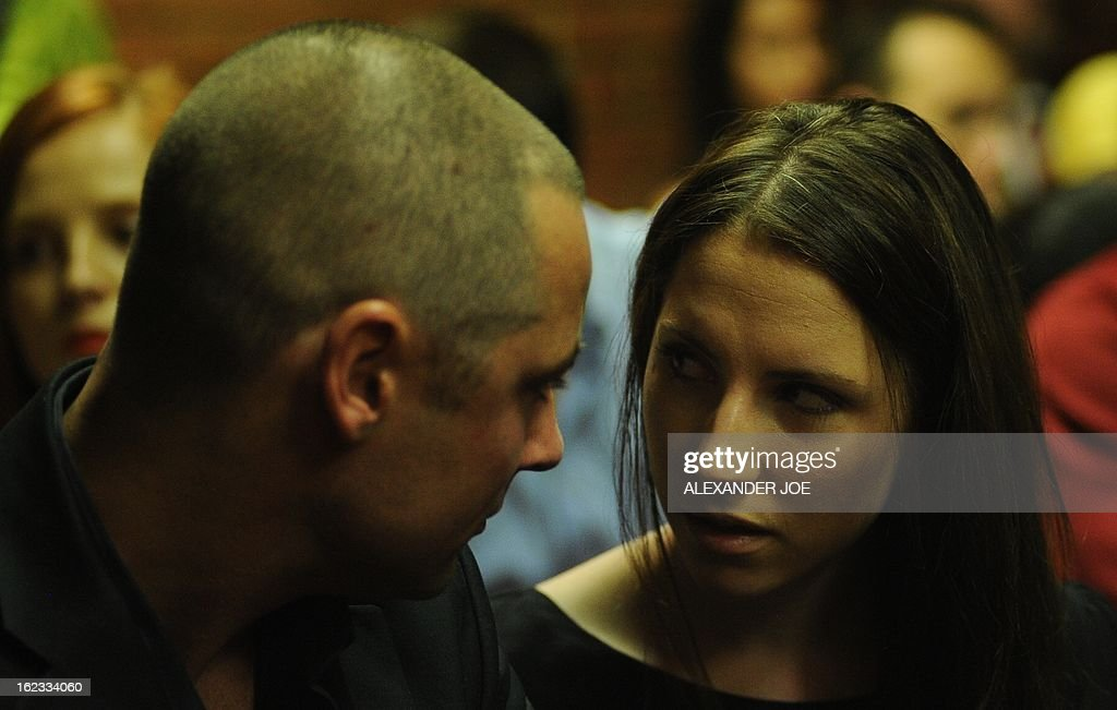 South African Olympic sprinter Oscar Pistorius's brother Carl (L) and sister Aimee wait on February 22, 2013 at the Magistrate Court in Pretoria. Pistorius battled to secure bail as he appeared on charges of murdering his model girlfriend Reeva Steenkamp on February 14, Valentine's Day. South African prosecutors will argue that Pistorius is guilty of premeditated murder in Steenkamp's death, a charge which could carry a life sentence. Pistorius denies the charge, saying that he shot 29-year-old Steenkamp repeatedly through a locked bathroom door in the dead of night by accident, having mistaken her for a burglar.