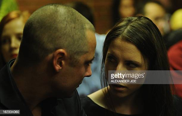 South African Olympic sprinter Oscar Pistorius's brother Carl and sister Aimee wait on February 22 2013 at the Magistrate Court in Pretoria Pistorius...