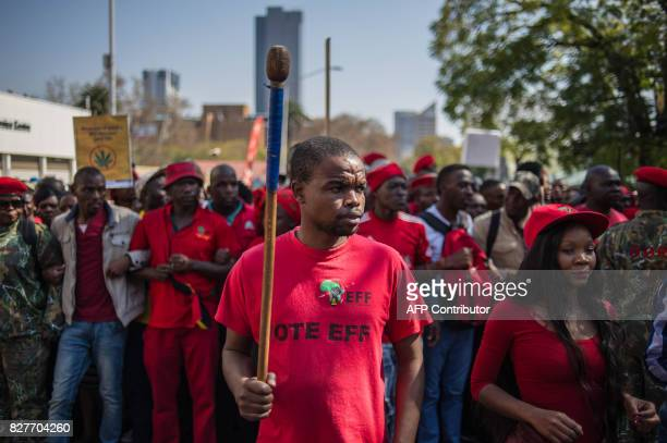 South African opposition Economic Freedom Fighter party activists shout slogans as they gather in Church Square in Pretoria on August 8 ahead of the...