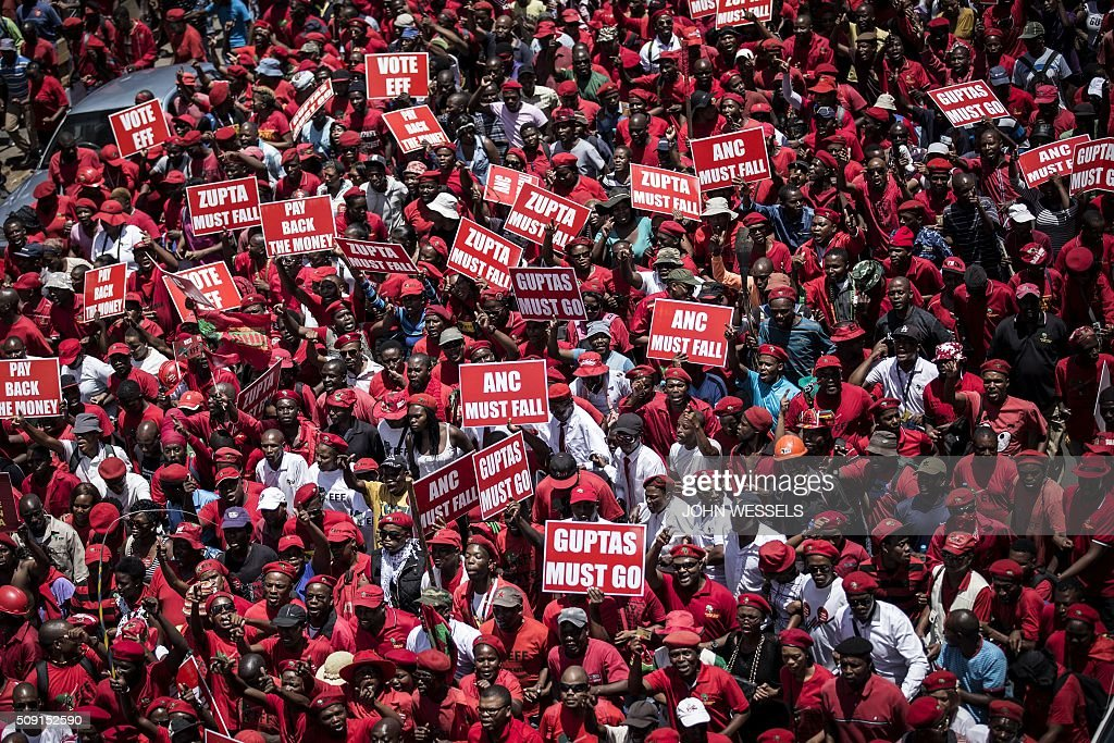 South African opposition Economic Freedom Fighter(EFF) supporters, march towards the constitutional court in Johannesburg on February 09, 2016 where judges heard a case over public money spent on President Jacob Zuma's private house. / AFP / JOHN WESSELS
