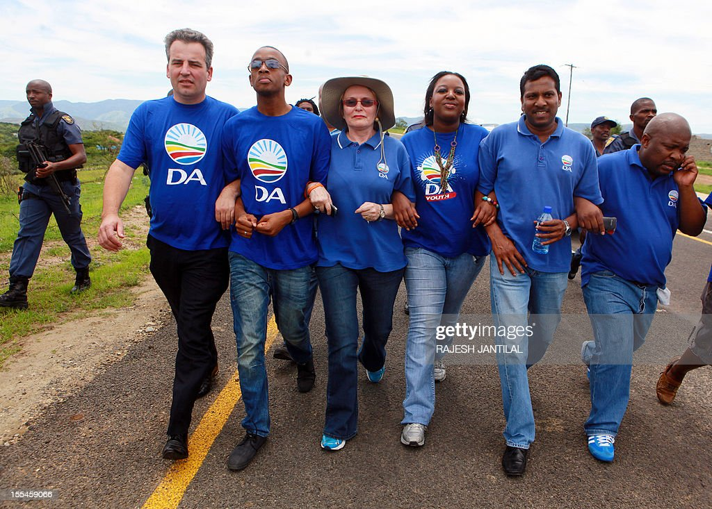 South African opposition leader Hellen Zille and her six-member delegation march toward President Jacob Zuma's private rural residence, before being stopped by African National Congress (ANC) supporters to visit him, at the centre of a row over a $29-million state-funded upgrade in Nkandla some 178 kilometres north of Durban on November 4, 2012. Police cited safety reasons for denying Zille passage to Zuma's homestead, where they wanted to inspect how public money was used to fund the president's private property.