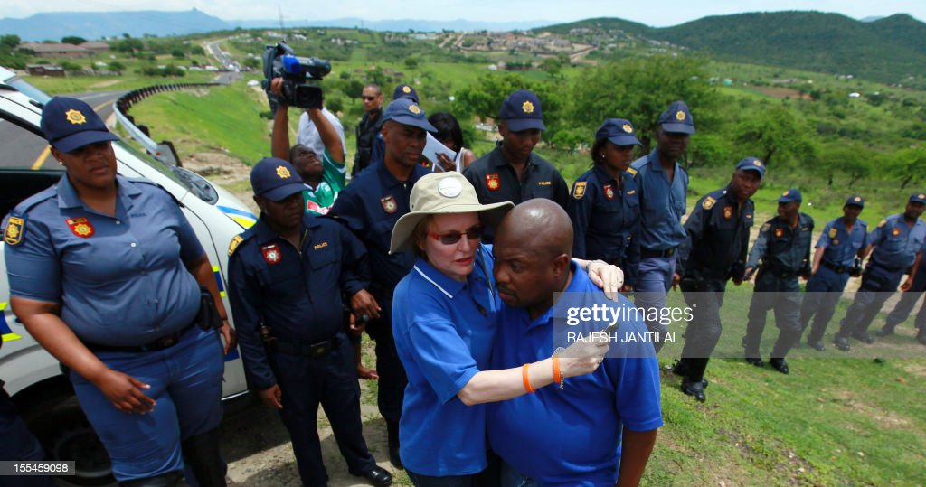 South African opposition leader Hellen Zille is blocked by members of the South African Police Services (SAPS) on her way to to President Jacob Zuma's private rural residence, at the centre of a row over a $29-million state-funded upgrade in Nkandla some 178 kilometres north of Durban on November 4, 2012. Police cited safety reasons for denying Zille and her six-member delegation passage to Zuma's homestead, where they wanted to inspect how public money was used to fund the president's private property. Supporters of the ruling African National Congress formed a barricade near the home, which is a cluster of modern thatched-roof Zulu huts. AFP PHOTO / RAJESH JANTILAL