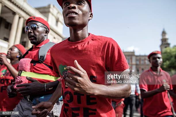 South African opposition party Economic Freedom Fighters' supporters shout as they demonstrate for the release of a report into corruption...