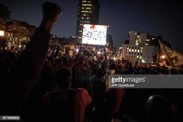 South African opposition party members react in Cape Town on August 8 as the outcome of a Motion of no Confidence against South African President...