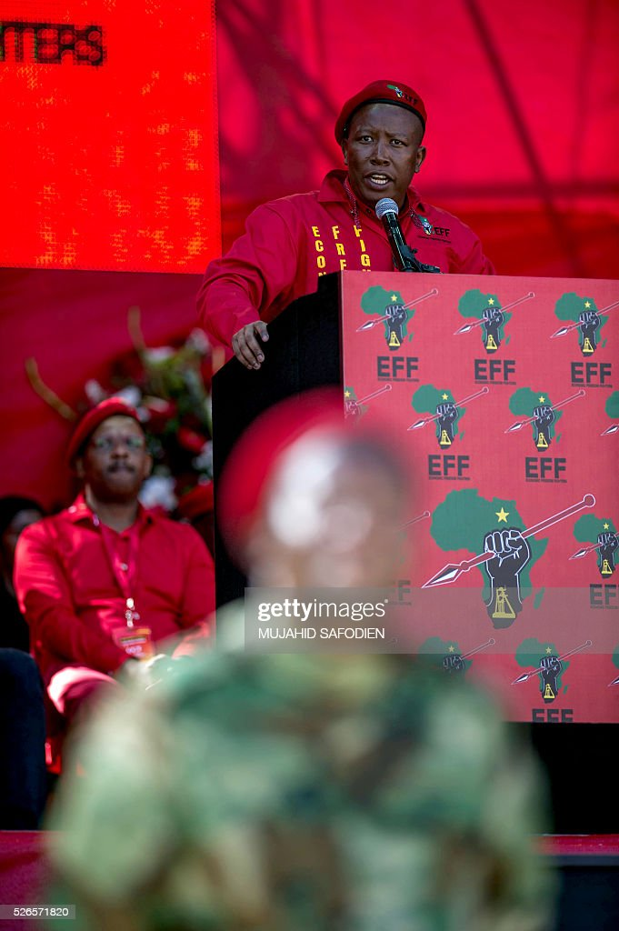 South African opposition radical party Economic Freedom Fighters leader Julius Malema addresses the supporters attending the EFF official local election manifesto launch at Soweto's Orlando Stadium in Johannesburg on April 30, 2016. Around 40,000 people turned Orlando stadium in Soweto into a sea of red as supporters roared their approval of fiery EFF leader Julius Malema's promises to seize white-owned land without compensation and nationalise the banks, targeting white privilege and the ruling African National Congress. / AFP / MUJAHID