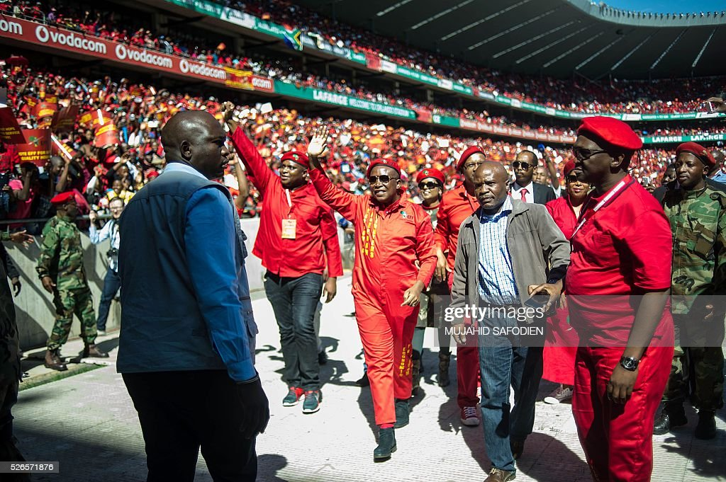 South African opposition radical party Economic Freedom Fighters leader Julius Malema arrives to address the supporters attending the EFF official local election manifesto launch at Soweto's Orlando Stadium in Johannesburg on April 30, 2016. Around 40,000 people turned Orlando stadium in Soweto into a sea of red as supporters roared their approval of fiery EFF leader Julius Malema's promises to seize white-owned land without compensation and nationalise the banks, targeting white privilege and the ruling African National Congress. / AFP / MUJAHID