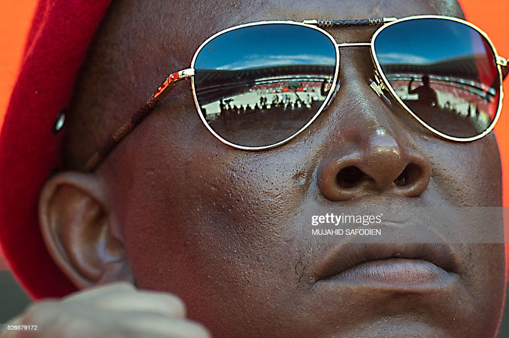 South African opposition radical party Economic Freedom Fighters leader Julius Malema is pictured during the EFF official local election manifesto launch at Soweto's Orlando Stadium in Johannesburg on April 30, 2016. Around 40,000 people turned Orlando stadium in Soweto into a sea of red as supporters roared their approval of fiery EFF leader Julius Malema's promises to seize white-owned land without compensation and nationalise the banks, targeting white privilege and the ruling African National Congress. / AFP / MUJAHID