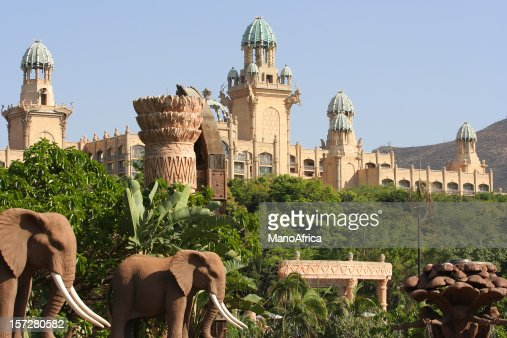 South African palace surrounded by trees and elephants
