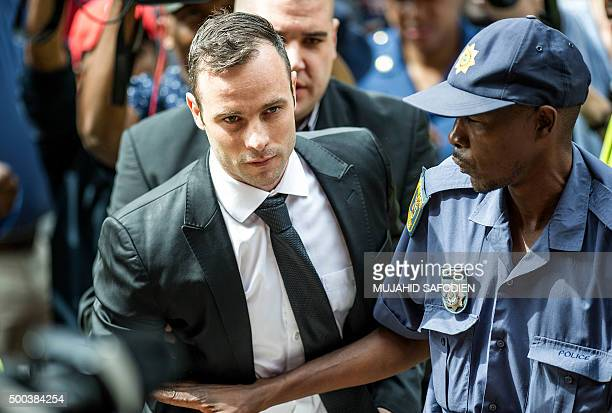 TOPSHOT South African paralympian Oscar Pistorius arrives to the Pretoria High court for a bail hearing on December 8 2015 Pistorius appeared in...
