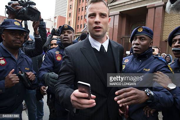 South African Paralympian Oscar Pistorius leaves at the high court in Pretoria on June 14 2016 on the second day of South African Paralympian Oscar...