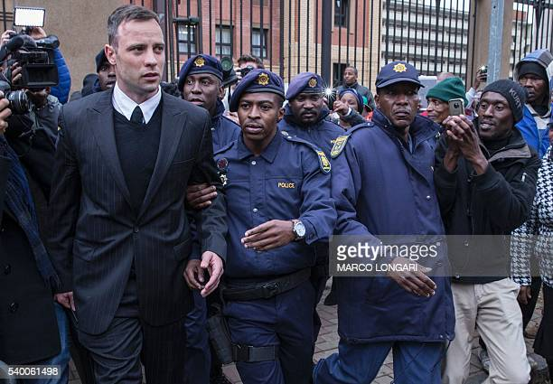 TOPSHOT South African Paralympian Oscar Pistorius leaves the high court in Pretoria on June 14 2016 on the second day of South African Paralympian...