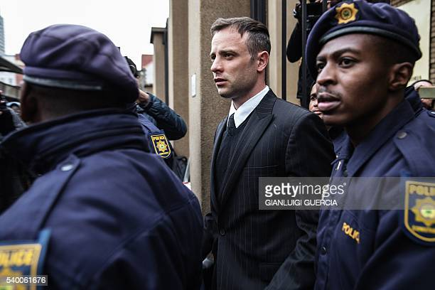 South African Paralympian Oscar Pistorius leaves the high court in Pretoria on June 14 2016 on the second day of South African Paralympian Oscar...