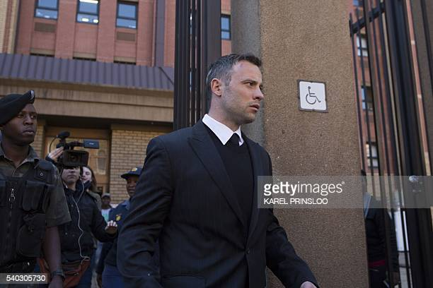 South African Paralympic athlete Oscar Pistorius leaves the Pretoria High Court during a lunch break on June 15 the third day of presentencing...