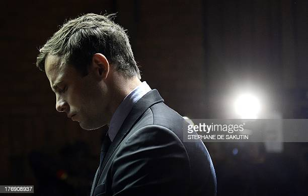 South African Paralympic sprinter Oscar Pistorius appears at the Magistrate Court in Pretoria on August 19 2013 Pistorius appeared on charges of...