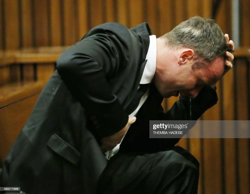 South African Paralympic track star <a gi-track='captionPersonalityLinkClicked' href=/galleries/search?phrase=Oscar+Pistorius&family=editorial&specificpeople=224406 ng-click='$event.stopPropagation()'>Oscar Pistorius</a> reacts as he listens to evidence by a pathologist during his trial in court in Pretoria on April 7, 2014. As the defence opens its case, the 27-year-old Paralympian will give the court his first account of why he shot dead his model girlfriend Reeva Steenkamp in the early hours of Valentine's Day in 2013.