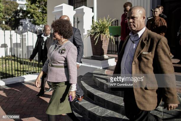 South African Parliament Speaker Baleka Mbete leaves Parliament after giving a press conference to announce procedure for the voting on the Motion of...