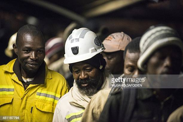South African platinum miners queue to undergo essential medical and safety procedures before working early on June 25 2014 at the Wonderkop mines in...